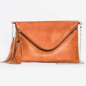 Tassel fold over crossbody clutch